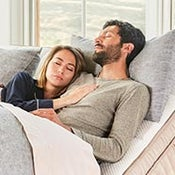 couple relaxing on dreamcloud's twin xl size adjustable bed frame - thumbnail
