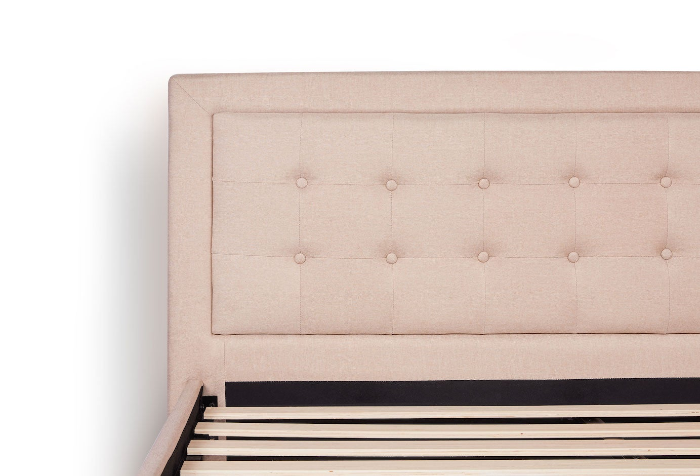 Dreamcloud's button tufted upholstered headboard
