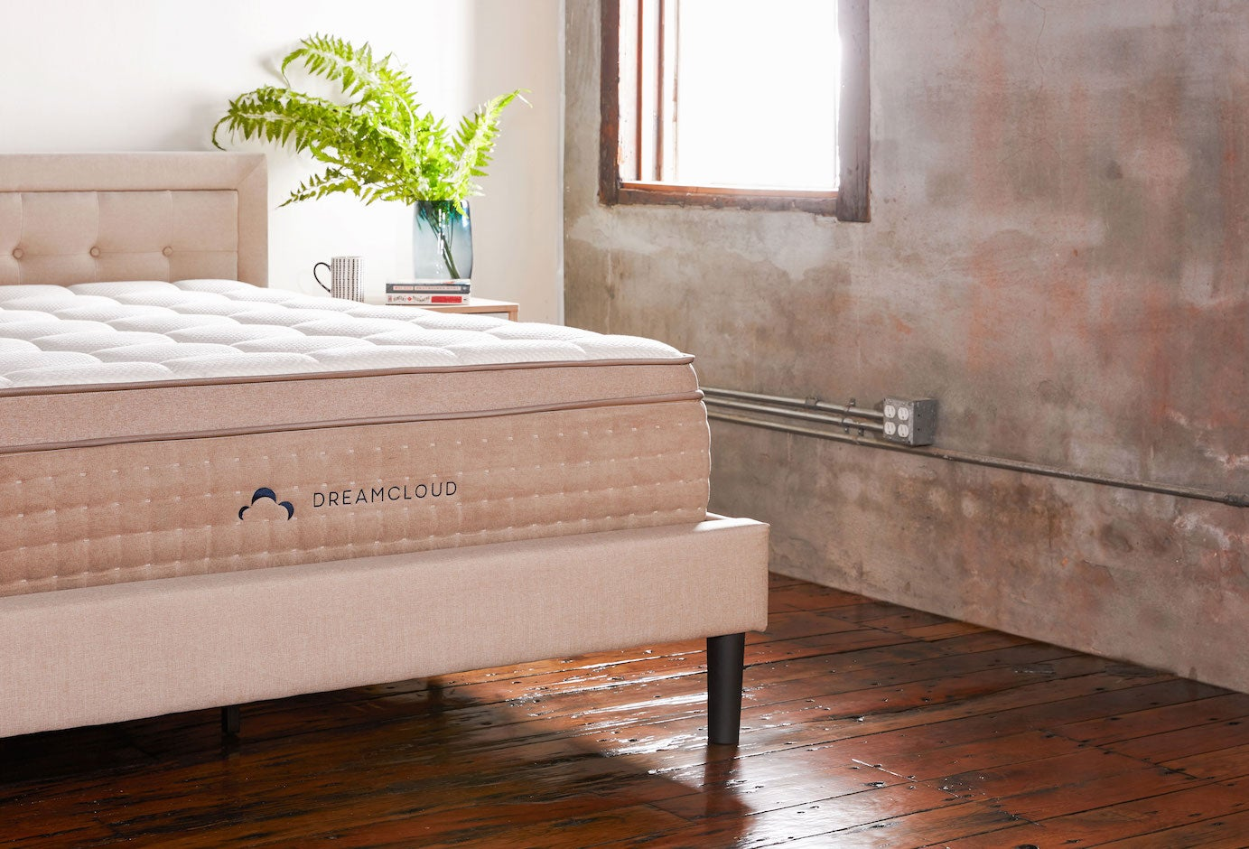 Dreamcloud's upholstered bedframe with headboard